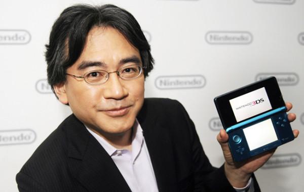 Satoru Iwata with a Nintendo DS